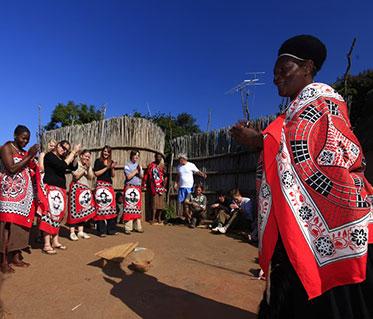 Swaziland, KwaZulu-Natal and Kruger Safari woman in lesedi village