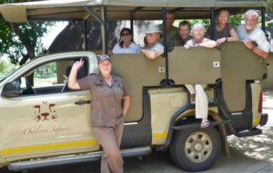 guests on an open safari vehilce ready for their game drive